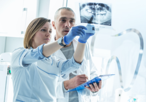 Two Dental Specialists Checking Dental X-Ray   Imagen Dental Partners