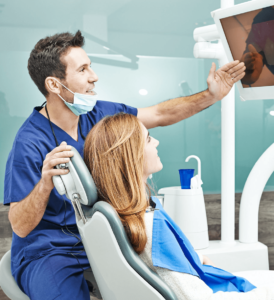 Dentist Showing Results to the Patient | Imagen Dental Partners