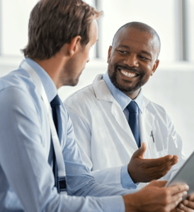 Two Doctors Discussing the Files | Imagen Dental Partners